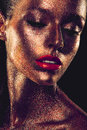 Beautyful girl with gold glitter on her face and red lips Stock Images