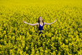 Beautyful teen model in canola field happy teenager beauty with blue dress Stock Photos