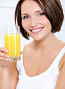 Beauyl smiling woman with glass of  juice Royalty Free Stock Photos