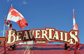 Beaver Tails sign with Canadian Flags Royalty Free Stock Photo