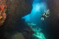 Beaytiful latina diver inside a canyon black hair young and pretty mexican scuba in the reef and blue sea cave Stock Photography