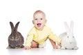 Bebé y conejos Fotografía de archivo