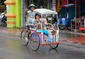 Becak driver and passenger in makassar sulewesi the traditional mode of transport the indonesian city of is the or bicycle Stock Images