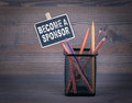 Become a Sponsor. A small blackboard chalk and colored pencil on wood background Royalty Free Stock Photo
