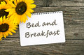 Bed and breakfast sunflower card with lettering Stock Images
