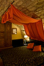 Bed with Canopy in a Bedroom. Royalty Free Stock Photos