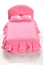 Bed pink miniature on white background Royalty Free Stock Image