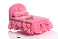 Bed pink miniature on white background with books and hearts Royalty Free Stock Images