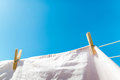Bed sheet drying on a rope outside Royalty Free Stock Photo