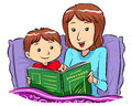 Bed time story mother reading for her son Royalty Free Stock Photography