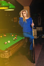 Beddable younge beauty woman posin at pool table billiard sport concept american billiard billiard game Royalty Free Stock Photography