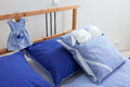 Bedding in blue and white incrustation on bed chequered Stock Images