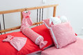 Bedding in red and white incrustation on bed chequered Stock Images