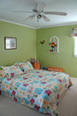 Bedroom decorated in green tones Stock Images