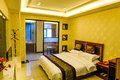 Bedroom of deluxe suites in hotel this is the a business taken chongqing city china Royalty Free Stock Photo