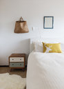 Bedroom details of retro decor side table and wall ornaments Royalty Free Stock Photo