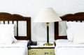 Bedroom with furnishings in a hotel and lamp Stock Photo
