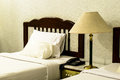 Bedroom with furnishings in a hotel and lamp Royalty Free Stock Image