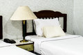 Bedroom with furnishings in a hotel and lamp Royalty Free Stock Photo