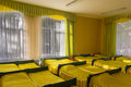 Bedroom in kindergarden rows of beds yellow Royalty Free Stock Photo