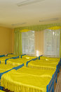 Bedroom in kindergarden rows of beds yellow Royalty Free Stock Photography