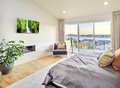 Bedroom in luxury home with view of trees Stock Photography