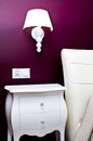 Bedroom nightstand lamp violet walls Stock Photo