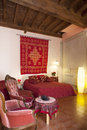 Bedroom in red colors interior of tuscany style hotel la gemma di elena lucca italy Royalty Free Stock Images