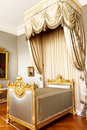 Bedroom with royal canopy bed Royalty Free Stock Photo