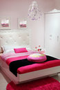 Bedroom with white wardrobe and pink carpet. Royalty Free Stock Images