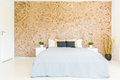 Bedroom with wooden mosaic wall Royalty Free Stock Photo