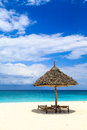 Beds and umbrella on a white sand beach tropical Stock Photography