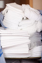 Bedsheets stacked in stock room closeup of store of hotel Stock Images