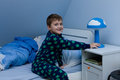 Bedtime cute little boy just about going to sleep Royalty Free Stock Photo