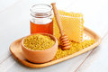 Bee pollen bowl full of with honey comb sweet food Royalty Free Stock Images