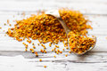 Bee pollen raw organic over wooden board Stock Photos