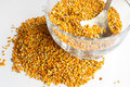 Bee pollen raw organic over wooden board Royalty Free Stock Photo