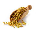 Bee pollen in a wooden scoop Royalty Free Stock Images