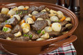 Beef bourguignon famous french stew cooked in red wine with onions mushrooms bacon and carrots Stock Image
