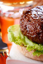 Beef burger with fork and beer on background Stock Image