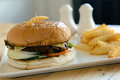 Beef burger and french fries served on white plate Royalty Free Stock Photo