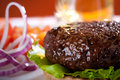 Beef burger with onion and beer on background Stock Photography