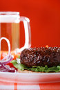 Beef burger with onion and beer on red background Stock Photos