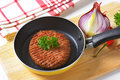 Beef burger patty in pan fried Royalty Free Stock Photos