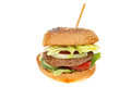 Beef burger with salad in a toasted sesame seeded bun isolated against white Royalty Free Stock Image