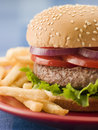 Beef Burger in a Sesame Seed Bun with Fries Stock Photos
