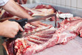 Beef carcass a butcher cuts a fresh in a close up image Royalty Free Stock Photography