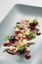 Beef carpaccio plated starter appetizer Royalty Free Stock Image