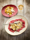 Beef carpaccio with slice mushroom Royalty Free Stock Photo