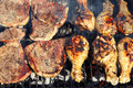 Beef and chicken barbecue cooking on the grill Royalty Free Stock Photography